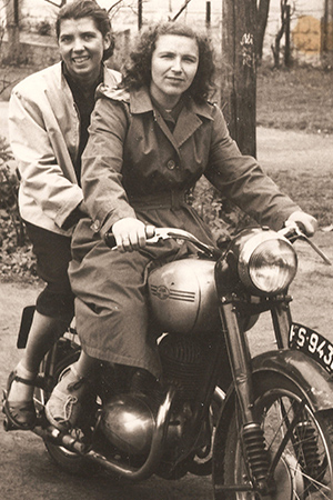 Janina on motorcycle with colleague