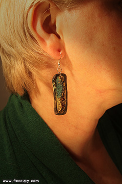 Handcrafted oblong ceramic earrings for sale.