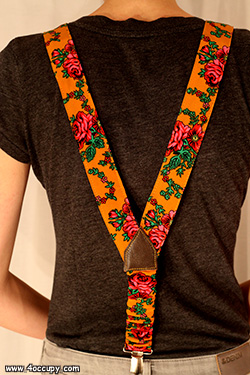 Handcrafted orange suspenders for sale.