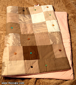 Handcrafted patchwork quilt for sale.