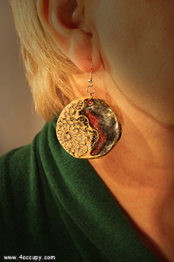 Handcrafted round ceramic earrings for sale.