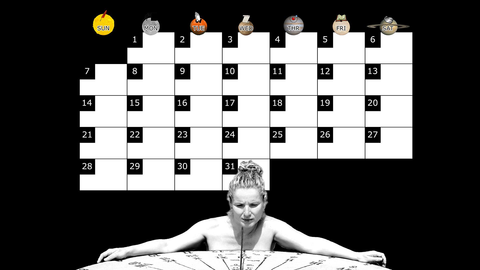 A monthly desktop calendar for December 2014 with a black background